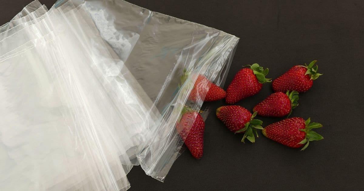 Freeze Macerated Strawberries - Strawberries next to ziploc bags.